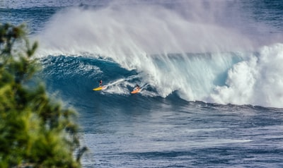 A surf shop owner gets paid to surf and a couple of strangers buy a few tickets to an upcoming event